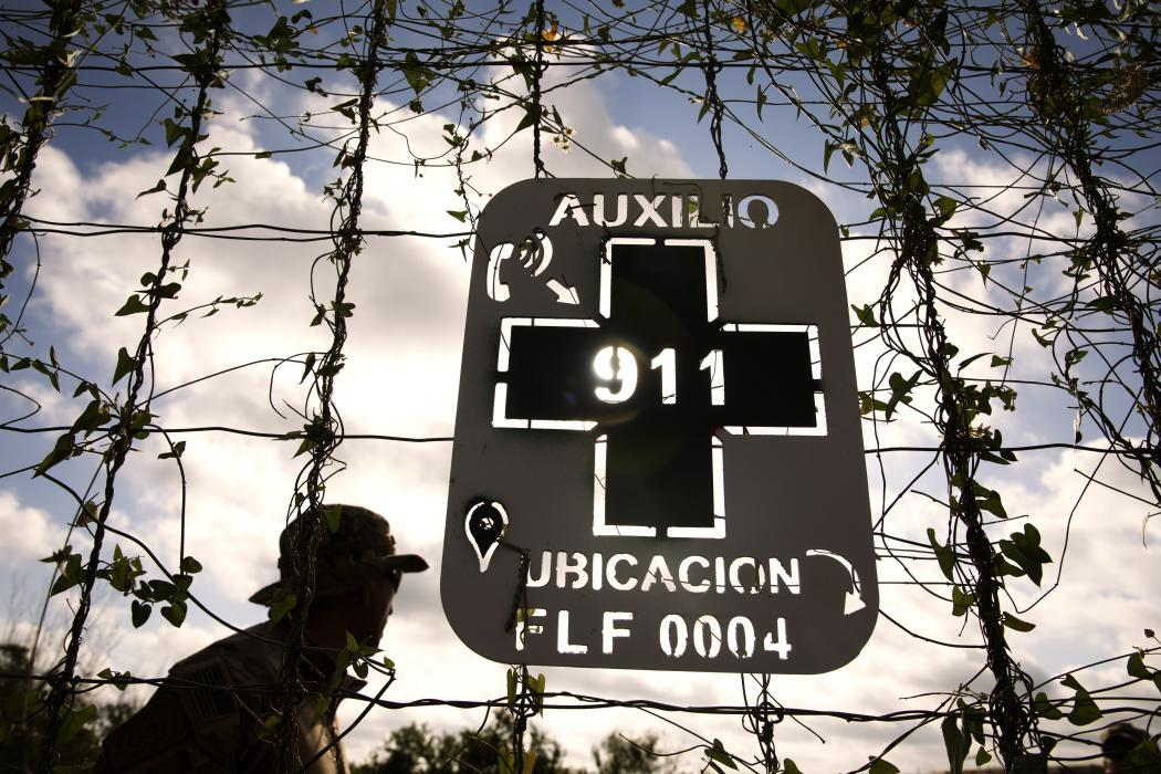 A sign posted by Border Patrol on a ranch in South Texas tells lost illegal aliens their exact location to speed their rescue by