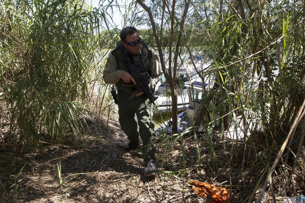 Photo of a Border Patrol agent patroling on shore.