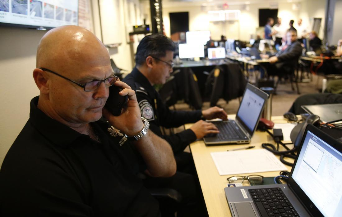 Photo of a CBP employee working at the command center in Santa Clara, California