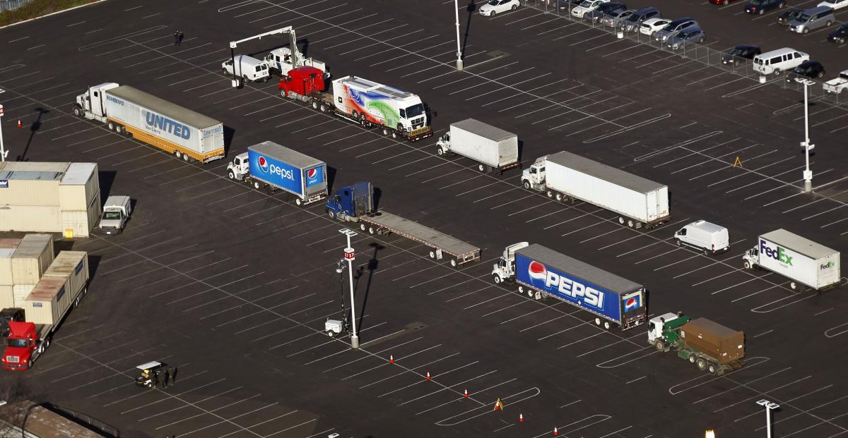 Photo of trucks lined up next to Levi's Stadium for X-ray screening before deliveries to the stadium are authorized
