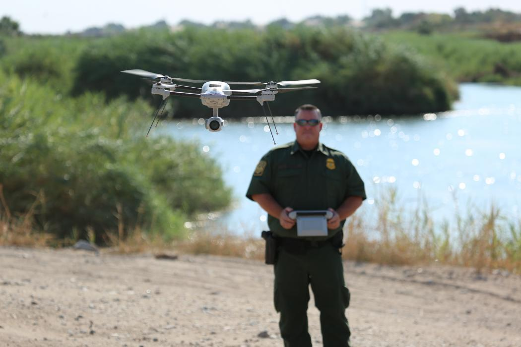 Border Patrol agent flying small drone