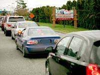 Vehicles cross the border from Canada through United States port of entry.