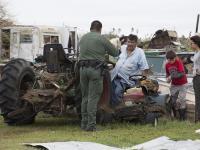 U.S Border Patrol agent Mario Fuentes talks with a family after Hurricane Harvey