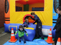Kids playing in a bounce house.