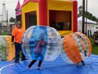Children playing a friendly game of bubble ball