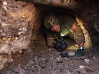 Border Patrol agent inspects a tunnel near Nogales, Ariz.