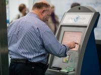 An arriving passenger uses a Global Entry kiosk.