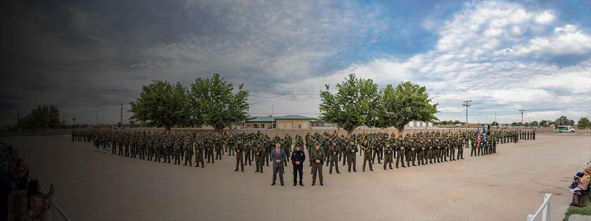 C2 stands in front of latest graduating class of USBP agents