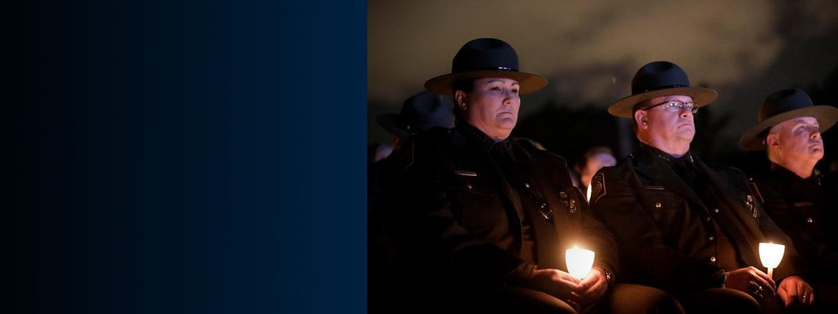 BP Chief Provost and Deputy Chief Luck watch as names of fallen law enforcement officers are reading during candlelight vigil