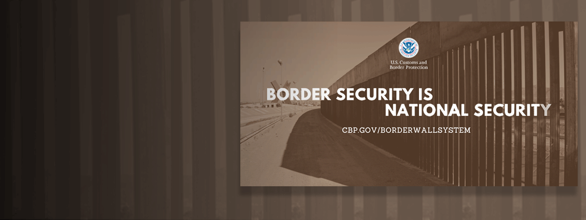 "Image of border wall system in background with ""Border Security is National Security: cbp.gov/borderwallsystem"""