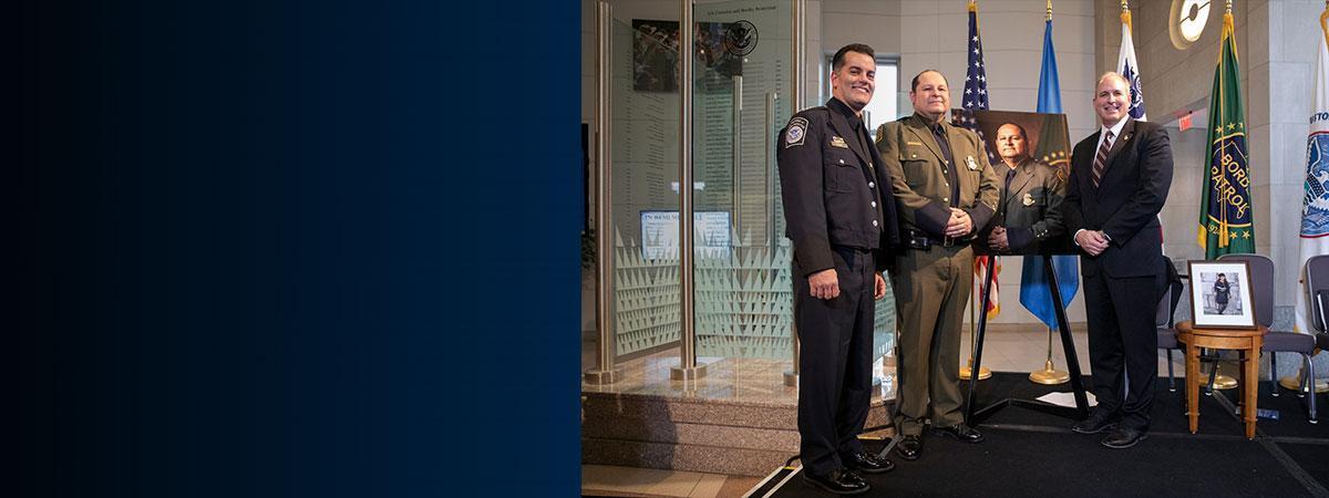 Acting CBP Commissioner Mark Morgan, and CBP Deputy Commissioner Robert Perez, congratulate Border Patrol Agent Jonathan Morales