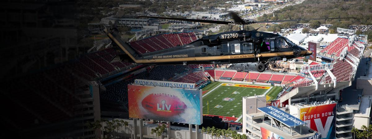 An Air and Marine Operations UH-60 Black Hawk helicopter and crew from Miami patrol the airspace over Raymond James Stadium