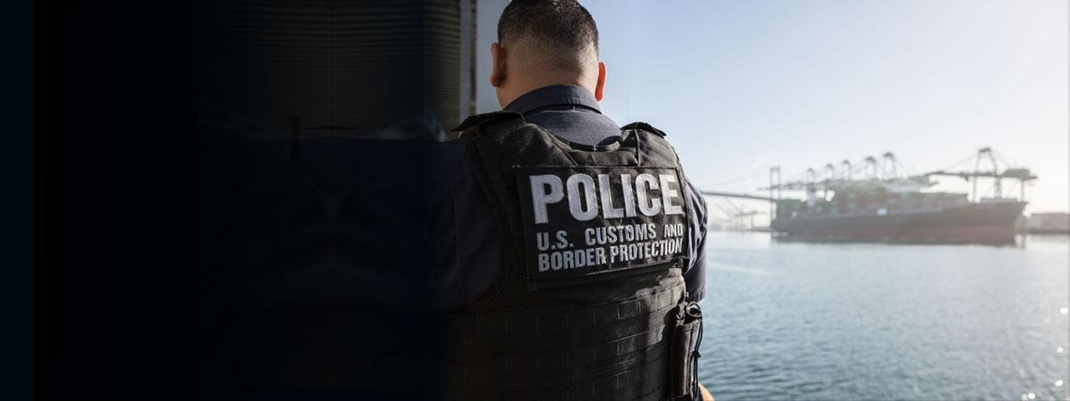 A CBP officer at the port of Los Angeles-Long Beach in California, awaits a cargo ship for inspection