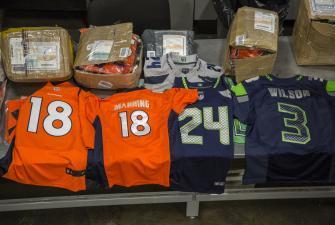Piles of counterfeit football jerseys.