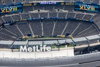 A CBP Black Hawk helicopter flies over MetLive stadium prior to the Super Bowl.