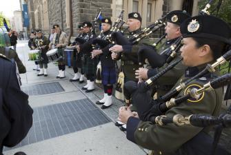 CBP Pipes and Drum Honor Guard performs at Blue Mass.