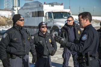 CBP officers deploy high-tech scanning equipment outside stadium to screen all trucks.