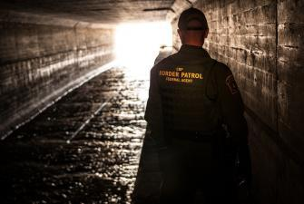 Border Patrol agent inspects a water drainage tunnel that spans from Nogales, Ariz. into Mexcio.
