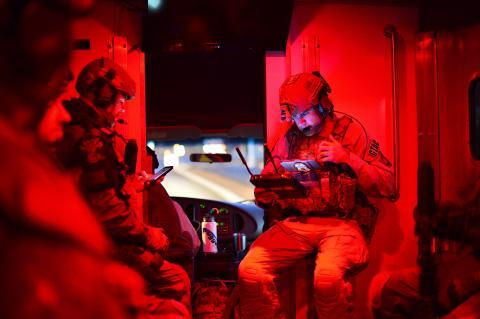 An AMO Ground Team Air Coordinator (GTAC) preparing for the execution of numerous search and arrest warrants in southern Arizona that dismantled a local drug trafficking organization suspected of distributing and selling heroin, marijuana, and various firearms.
