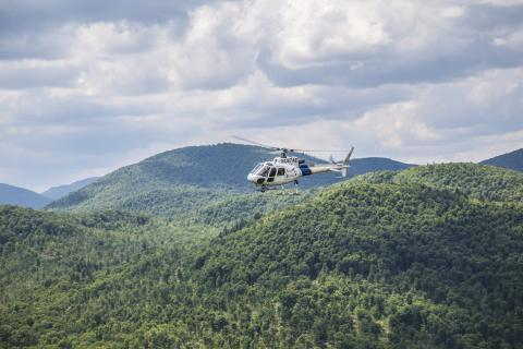 An AS350 crew assists in the hunt for escaped prisoners Richard Matt and David Sweat in upstate New York.