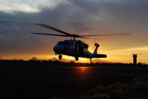 An Air and Marine Operations UH-60 crew takes off during a desert sunset near Tucson, Arizona