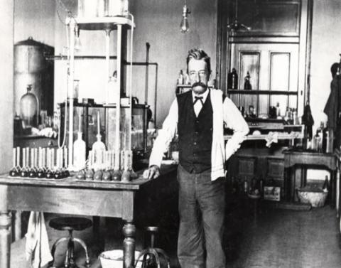 Chief Chemist Walter L. Howell stands in the laboratory in the U.S. Custom House in New Orleans, Louisiana. This Customs laboratory was established in 1900.