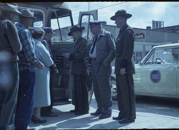 Border Patrol agents check bus passengers.