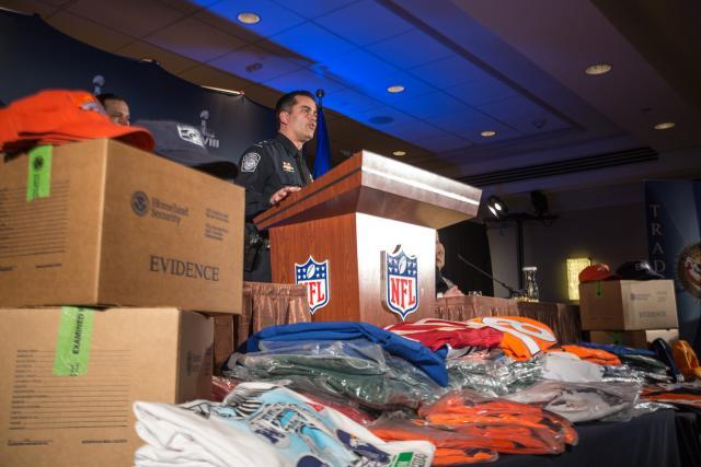 CBP officials describes confiscation of courterfiet goods prior to the 2014 Super Bowl.