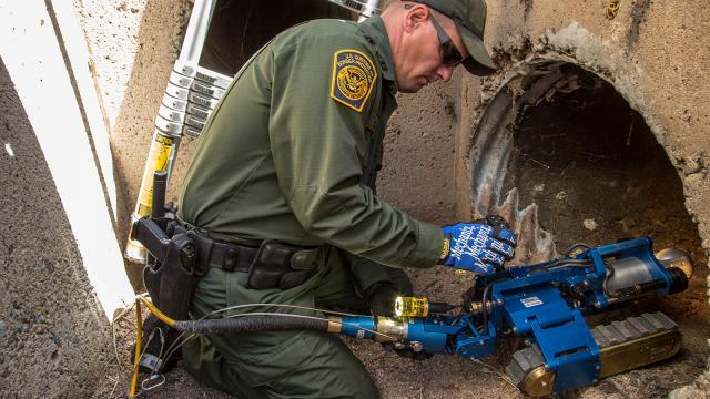A CBP robot is placed in a drainage pipe for exploration.