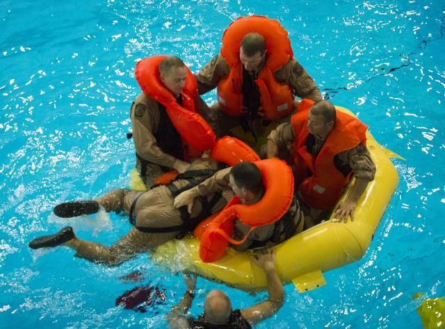 Water survival training gives agents an opportunity to practice boarding a raft.