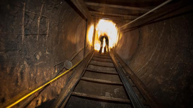 A Border Patrol agent exits the tunnel.