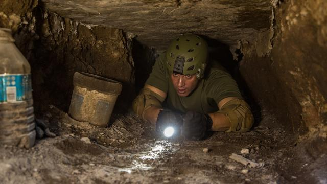 Supervisory Border Patrol Agent Kevin Hecht crawls the tunnel.