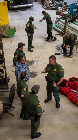 Border Patrol agents gather after exploring the tunnel. The building where the tunnel exits on the U.S. side of the border is now municipally owned building.
