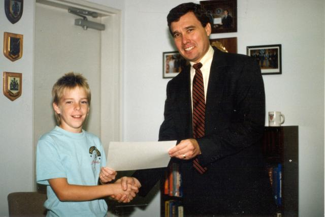 """Port St. Lucie, Florida, Police Chief R. Gil Kerlikowske presents a certificate to the youngster chosen as """"Police Chief for a Day"""" in 1988. Photo courtesy Port St. Lucie Police Department"""