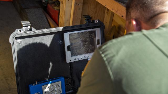 Supervisory Border Patrol Agent Kevin Hecht monitors the information relayed to a console by the robot as it explores the tunnel.