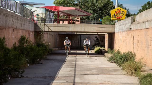 Border Patrol agents patrol the main drainage system on bikes in Nogales, Arizona.