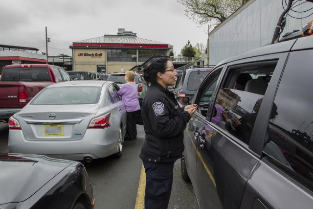 A CBP officer initiates pre-inspection processing by speaking with drivers queued to board one of the ferries between Victoria, British Columbia, and the U.S.
