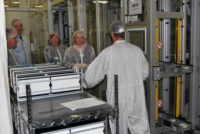 A SolarWorld employee shares details of solar cell production with CBP employees, l-r, Erich Mohr, Steve Lewis, Kristy Huckins and Katie Schultz<em>. </em>Photo by Ed Colford
