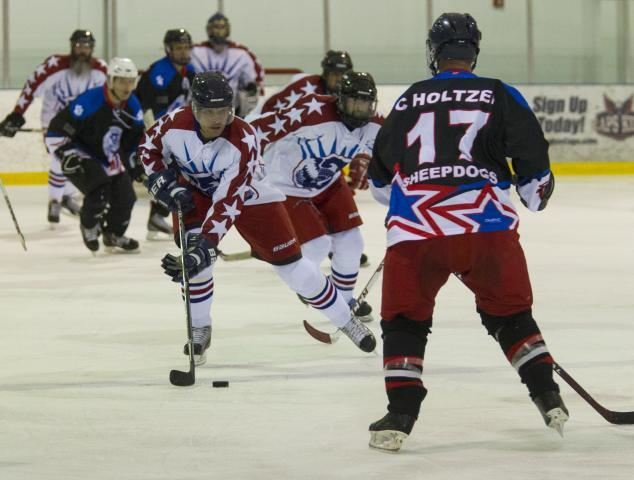 The CBP-ICE ice hockey team, in dark jerseys, defeated the Department of Homeland Security's team 4-2 in the first round at the 2015 World Police & Fire Games. Ice hockey matches were played throughout the tournament's seven days. Photo by James Tourtellotte