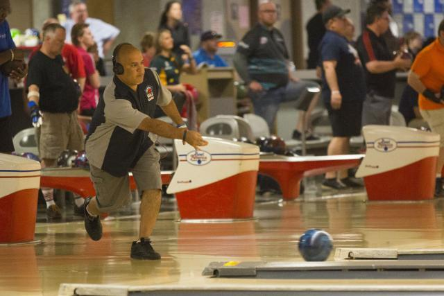 Hector Arredondo, CBP officer from the Sumas, Washington, goes for a strike at the 2015 World Police & Fire Games bowling tournament. Photo by James Tourtellotte