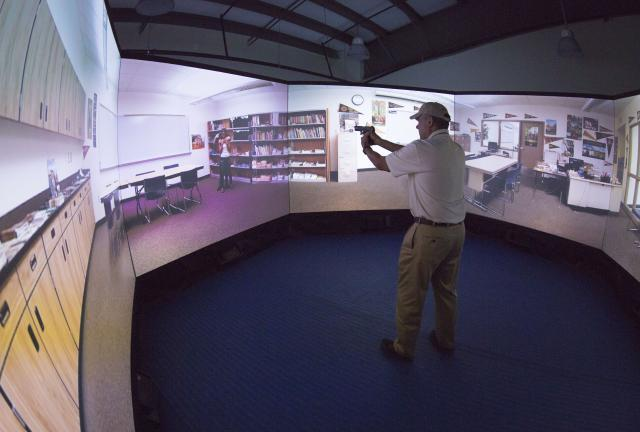 At CBP's Advanced Training Center in Harpers Ferry, West Virginia, Commissioner Kerlikowske gives his best shot in the virtual training simulator in August.
