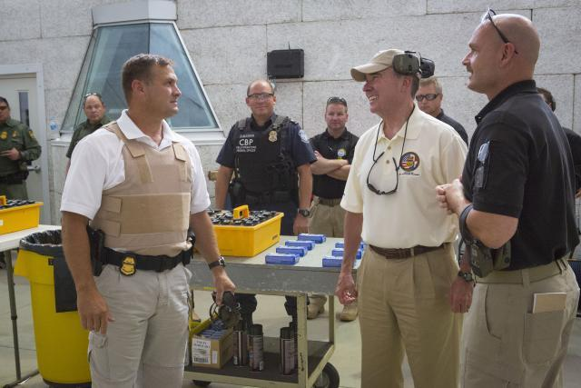 Commissioner Kerlikowske and CBP Advanced Training Center Assistant Director Dave Corolis, right, speak with Firearms Instructor Training Program participants at the center's firing ranges in August.
