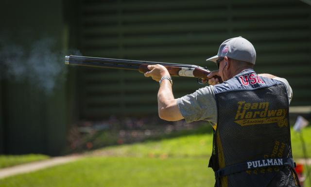 Michael Pullman, a CBP supervisory air interdiction agent, fires his Beretta shotgun in the trap shooting contest at the 2015 World Police & Fire Games, Centreville, Virginia. Photo by James Tourtellotte