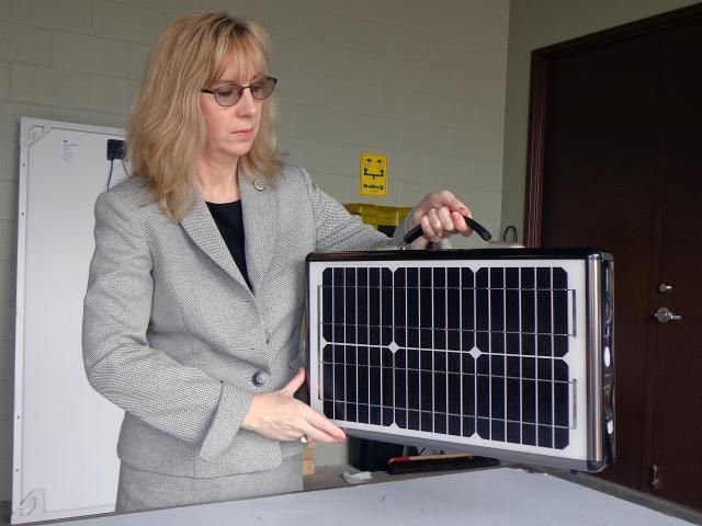 Senior Import Specialist Laurie Pazzo inspects a mobile solar power unit that was listed on shipping documents as a suitcase. Photo by Scott Sams
