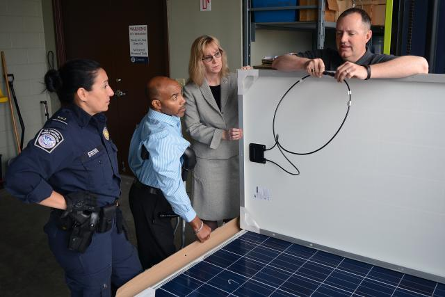 Import Specialist Jeff Sorrells explains electrical routing of solar panels to port of Charlotte teammates, l-r, Joyce Brown, Wilbert Jones, and Laurie Pazzo. Photo by Scott Sams