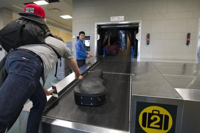 Preclearance travelers drop their checked luggage for secure baggage handling at Vancouver International Airport.Preclearance travelers drop their checked luggage for secure baggage handling at Vancouver International Airport.