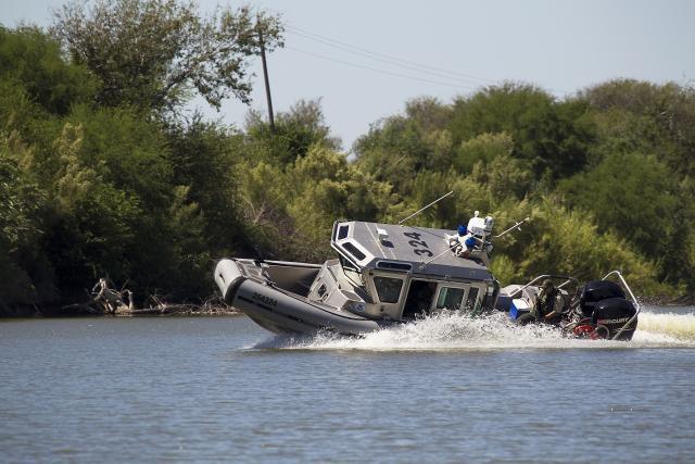 Border Patrol riverine agents maneuver a SAFE boat on the Rio Grande.