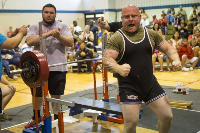 An exuberant Matt Phelps sets a 2015 World Police & Fire Games bench press world record. The Bonners Ferry, Idaho, Border Patrol agent reached his goal and his dream, lifting a remarkable 551 pounds. Photo by James Tourtellotte