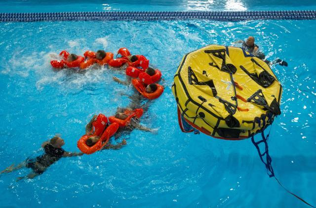 A human chain keeps survivors together, provides mobility and even warmth while moving through the water.
