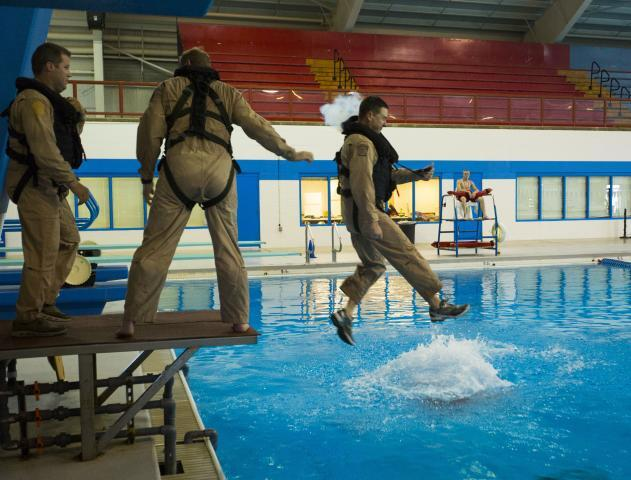 A diving platform is used to simulate an aircraft evacuation.